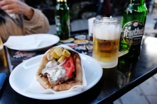 Pork gyros coupled with a mythos beer